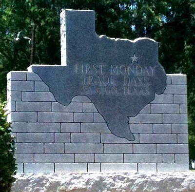 Stone sign of the State of Texas, downtown Canton, at the entrance to First Monday Trade Days